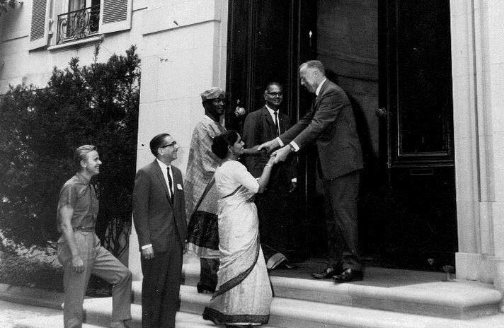 Andrew Harding greets international visitors in 1964 at Meridian House