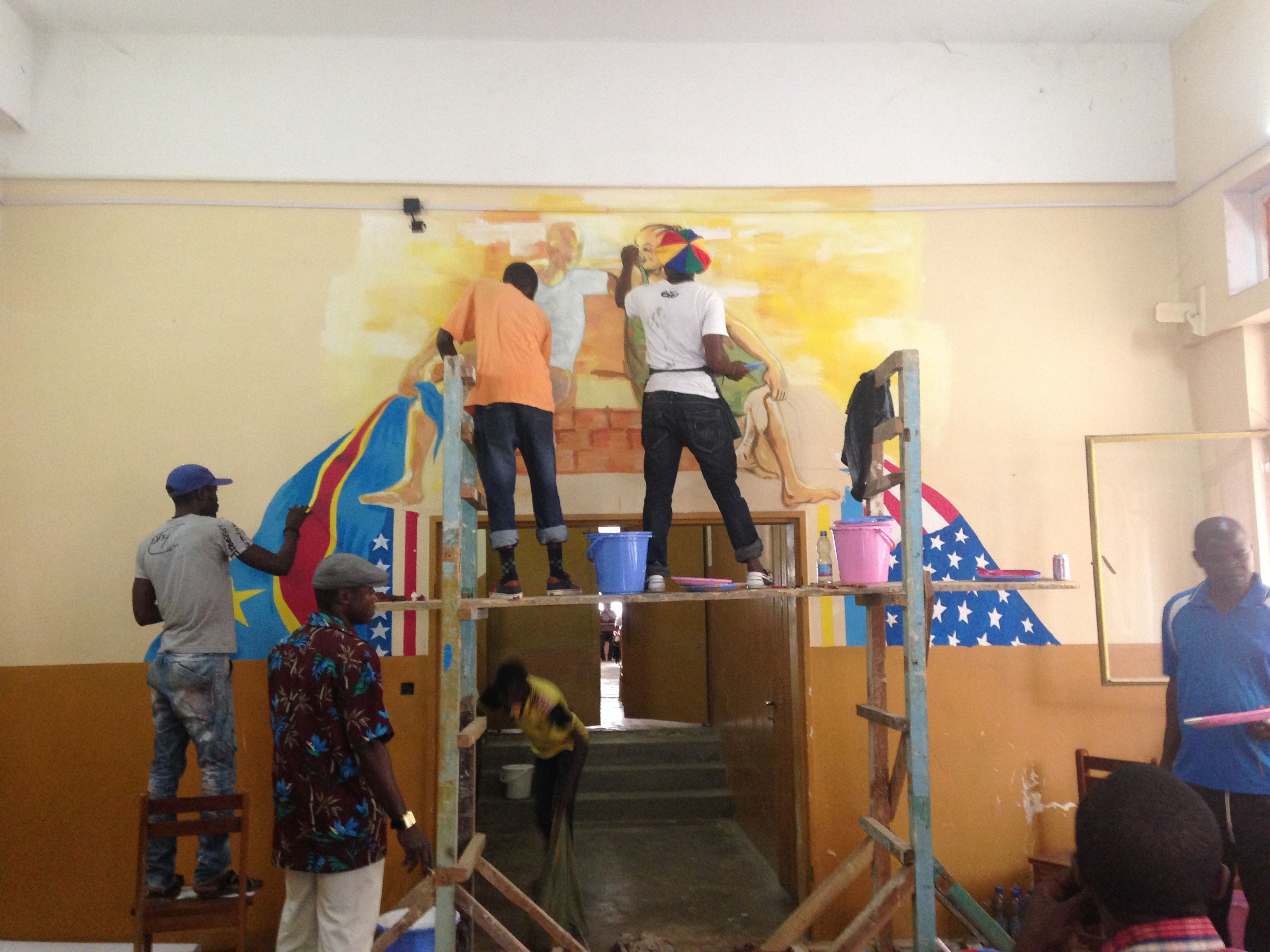 Local artists helping with the Matadi mural at the American Shelf.