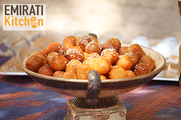 Loqmat, a traditional Emirati dessert made of butter, milk, sugar, flour, saffron, and cardamom, drizzled with date syrup/Courtesy Abu Dhabi Events.