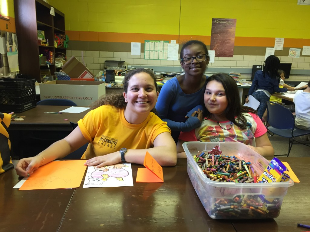 Tessa Trach, University of Maryland student, with girls at the Boys and Girls Club of Huntington.