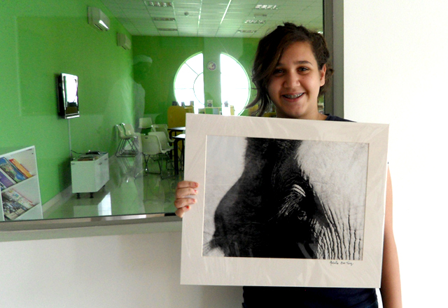 A FUNN participant creates a charcoal drawing during an art workshop dedicated to children/Courtesy of FUNN.