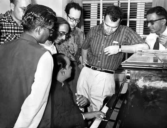 Dave Brubeck and Paul Desmond (center) encounter Indian musicians. Bombay, India, 1958. Courtesy of the Brubeck Collection, Holt-Atherton Special Collections, University of the Pacific Library. Copyright Dave Brubeck.