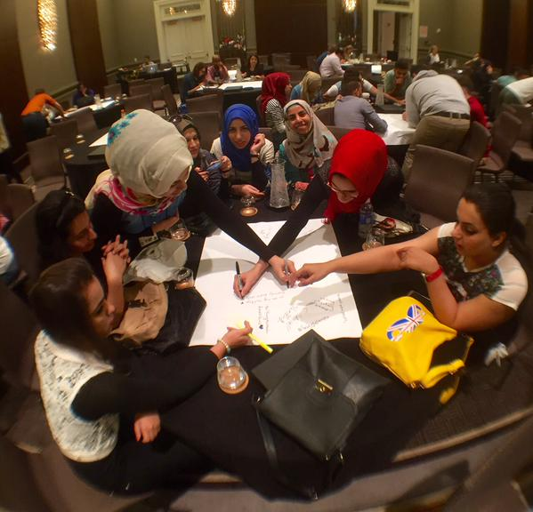 Students from the Iraqi Youth Leadership Exchange Program work together on a group project.