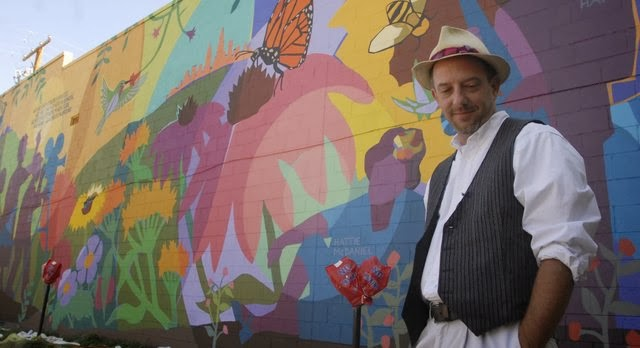 Dave with one of his celebrated public murals in his hometown of Lawrence, Kansas