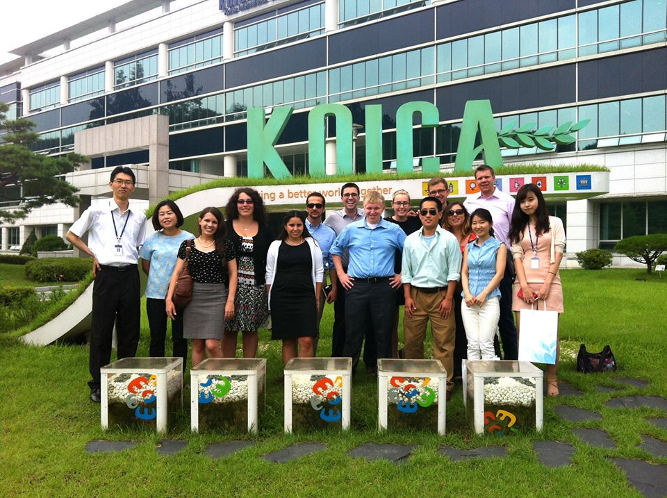 Joseph pictured on first on the right in the back row along with the other members of the U.S. delegation after visiting the Korean International Cooperation Agency - KOICA.