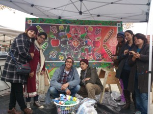 Pakistani Artists with the Collaborative Mural in Mt Pleasant