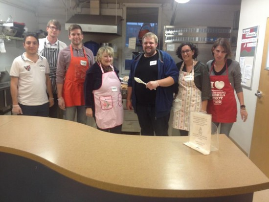 The visitors volunteered by serving meals at a homeless shelter for women in Denver, Colorado.
