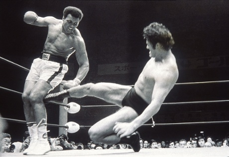 Antonio Inoki and Muhammad Ali during an exhibition fight in Tokyo, 1976. Photograph: Allsport Hulton/Archive/Getty. Source: http://bit.ly/1vKg1sp