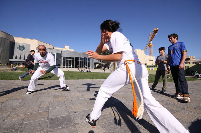 A Capoeira demonstration at the University of San Francisco during International Education Week. Capoeira is a form of martial arts from Brazil.  (Photo Credit: Shaun Calhoun)