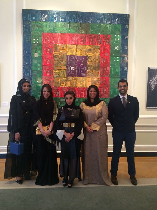 Maitha Demithan, Dana, Zeinab, Noor, and Khalid pose in front of Shaika Al Mazrou's 107 piece.