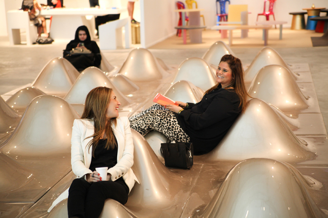 Design Days Dubai 2014 visitors try out the unique seating at the fair/Courtesy of Best Design Events.
