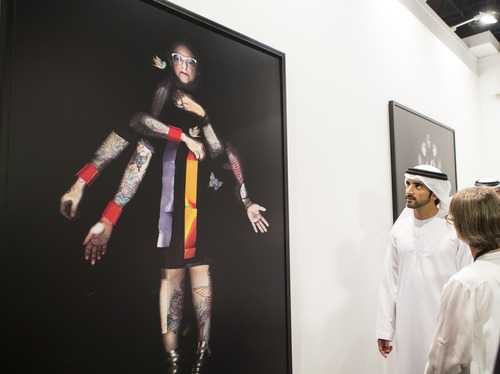 H.H. Sheikh Hamdan bin Mohammed bin Rashid Al Maktoum during his tour of Art Dubai 2014 viewing artwork by Maitha Demithan, another Past Forward artist/Courtesy of Art Dubai.