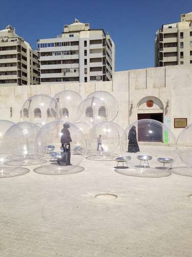 Kazuyo Sejima and Ryue Nishizawa of SANAA designed Bubble, 2013, a series of Plexiglas spheres, for a square near Sharjah's calligraphy museum/Courtesy of Architectural Record