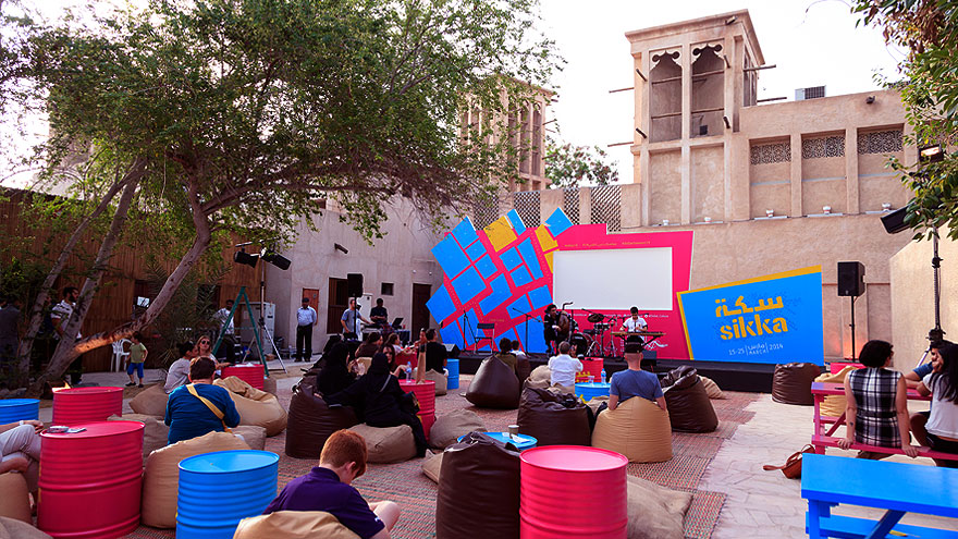 Visitors enjoying music at the SIKKA Art Fair located in Bastakiyah, a historical district of Dubai and a major destination during Dubai's art season/Courtesy of Dubai Culture.