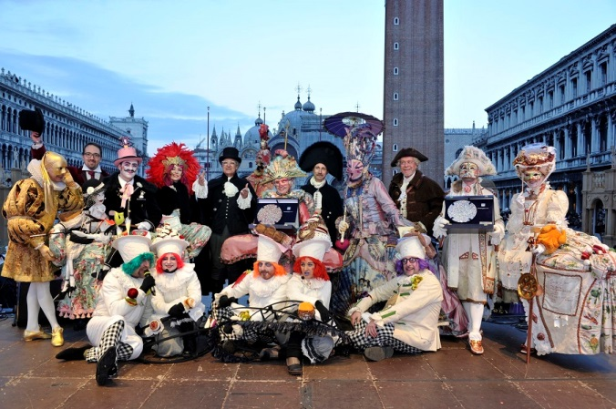 "Winners of best thematic masked costume ""the venetian kitchen"", best masked costume ""the love's stars: marte venere e cupido"", and the most original mask/Courtesy of Carnevale."
