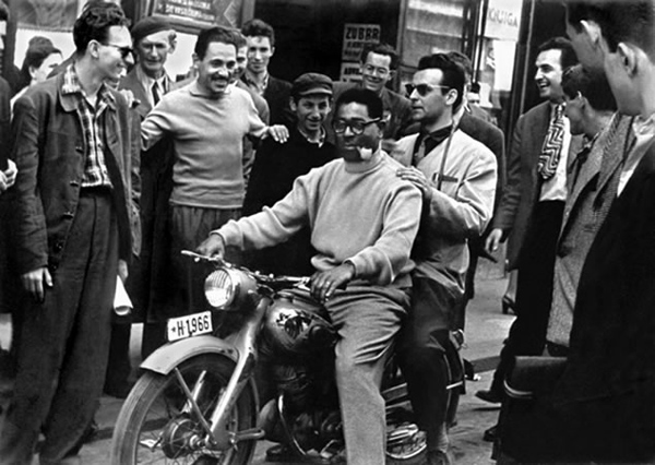 Dizzy Gillespie with Yugoslav musician and composer Nikica Kalogjera and fans. Zagreb, Yugoslavia, 1956. Courtesy of the Marshall Stearns Collection, Institute of Jazz Studies, Rutgers University.