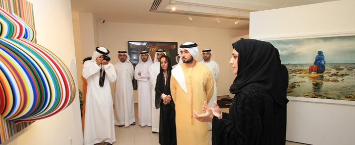 H.H. Sheikh Majed bin Mohammed bin Rashid Al Maktoum visits the Women's Museum, where artist Shaikha Al Mazrou, a Past Forward artist, discusses her work/Courtesy of Women's Museum.