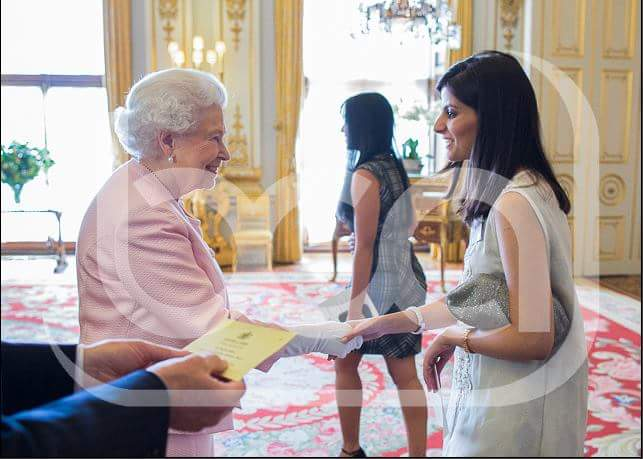 Meeting Her Royal Highness at Buckingham Palace.