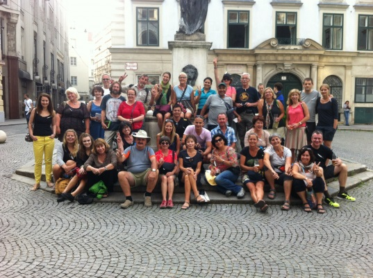 Some of the many Peace Walkers posing in front of a statue in Vienna. Photo courtesy of Lee LaTour.