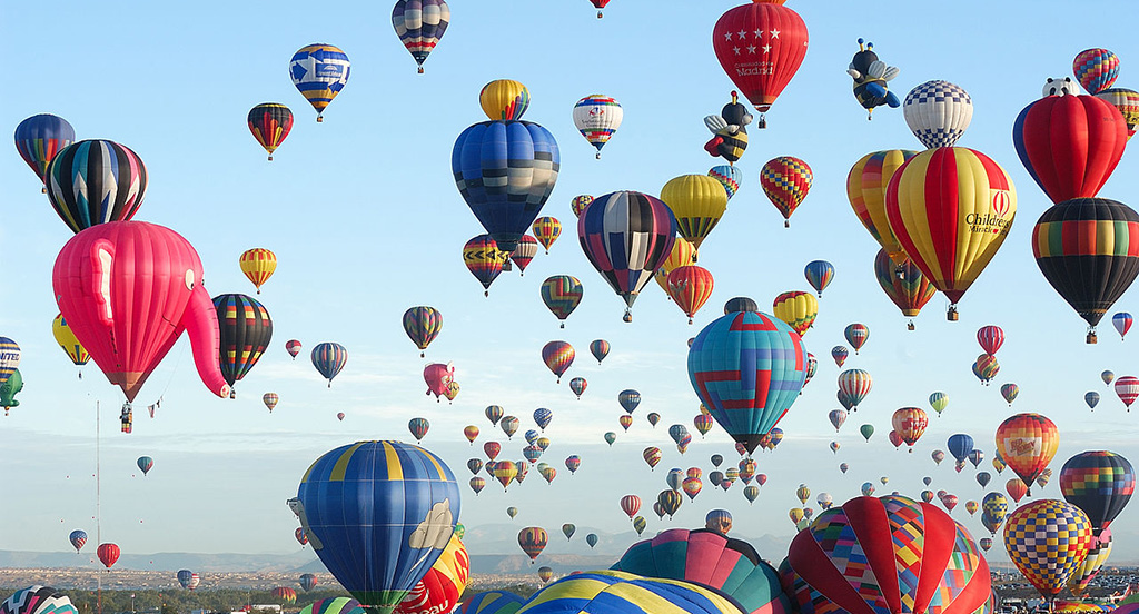 Balloons from 22 countries rise over the 44th Annual Albuquerque International Balloon Fiesta.