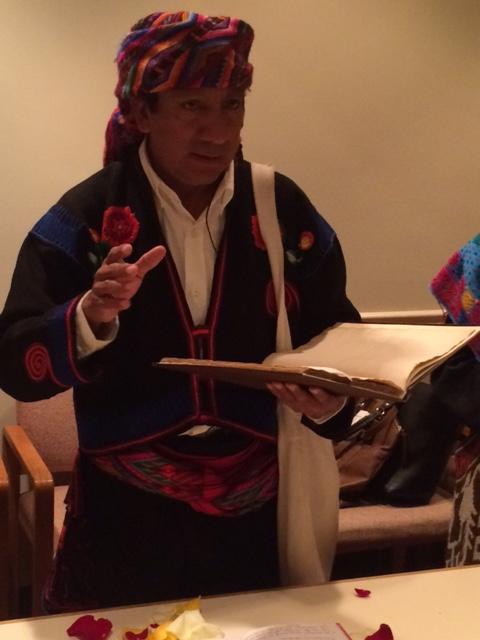 Leader Manuel Xol Tol reading from his ancestors sacred book, the Popol Vuh.