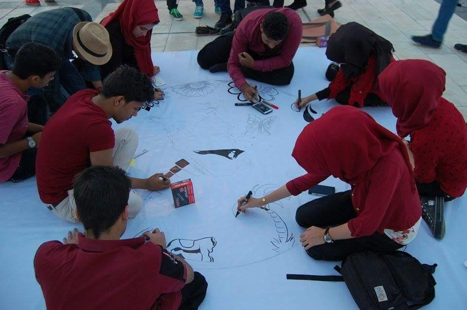 IYLEP graduates and volunteers creating artwork at the Basra City of Peace Festival.