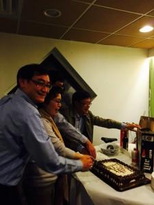 Meng Luo, Peijuan Wang, Guoqin Li and Huan Xu cut their surprise birthday cake together.