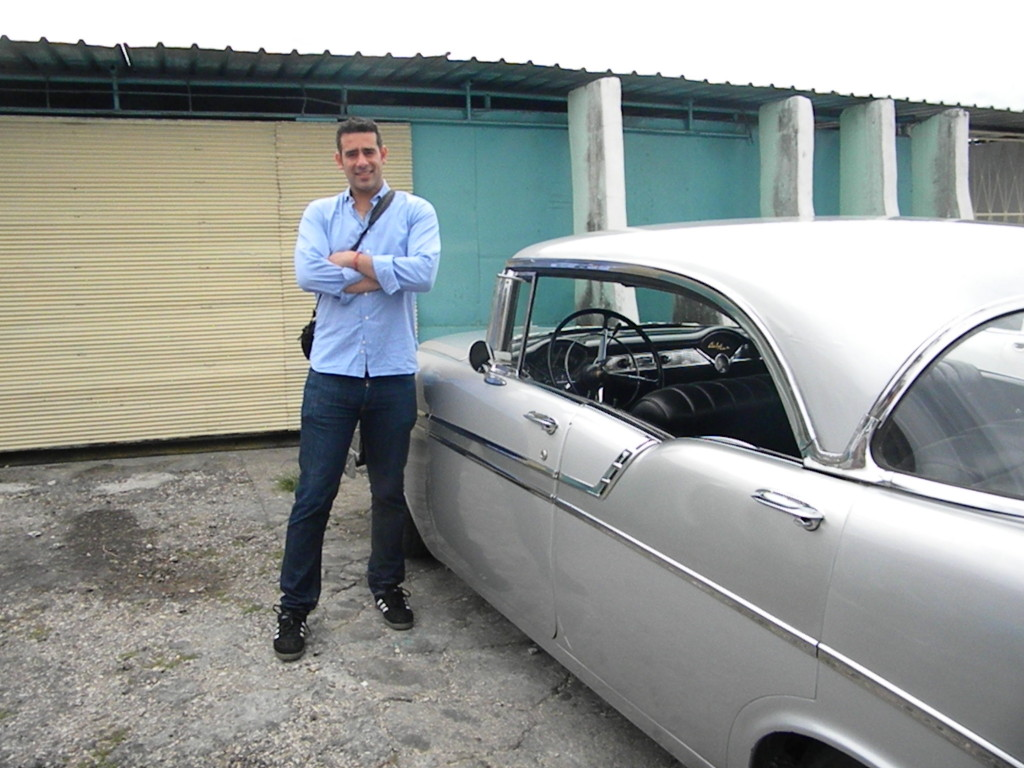 The Author posing with a restored vehicle at Nostalgicar.