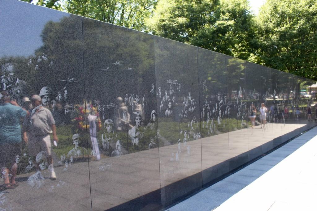 The long, reflective wall etched with 2,500 drawings of soldiers.