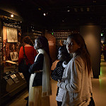 The girls observe and read about the history of the transatlantic slave trade and the affect it had on African Americans at The National Museum of African American History and Culture