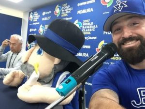 "Israeli infielder Cody Decker (born in Santa Monica, CA) and team mascot, ""Mensch"" at a WBC press conference. Photo courtesy of Cody Decker via Twitter"