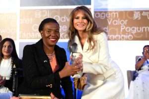 IWOC awardee Ms. Malebogo Molefhe receives the International Women of Courage Award from First Lady Melania Trump.