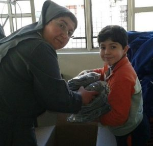 Sister Carol, a Salesian nun, works with displaced children at the nursery school she founded.