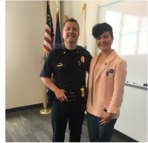 Pictured: IVLP participant Tamila Tasheva with Manchester Police Lieutenant Brian O'Keefe, who provided a first-hand account of what law enforcement culture in the United States is like. After his discussion, Lieutenant O'Keefe found himself in high demand, as the visitors were eager to snap a selfie.