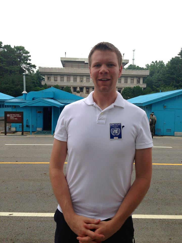 Joseph Schmoll with North Korea in the background while visiting the DMZ as part of the program.